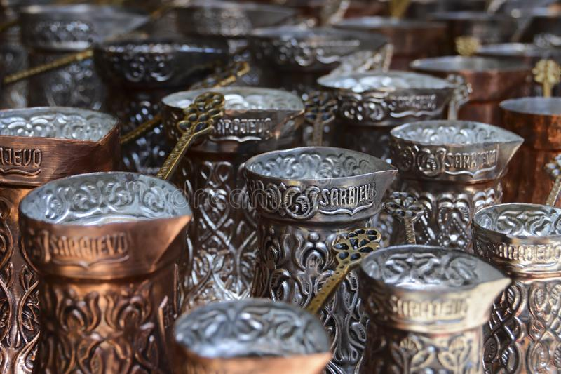 Traditional copper and silver-plated coffee pot souvenirs from Bosnia. Turkish coffee pots. Traditional copper and silver-plated coffee pot souvenirs from stock photo