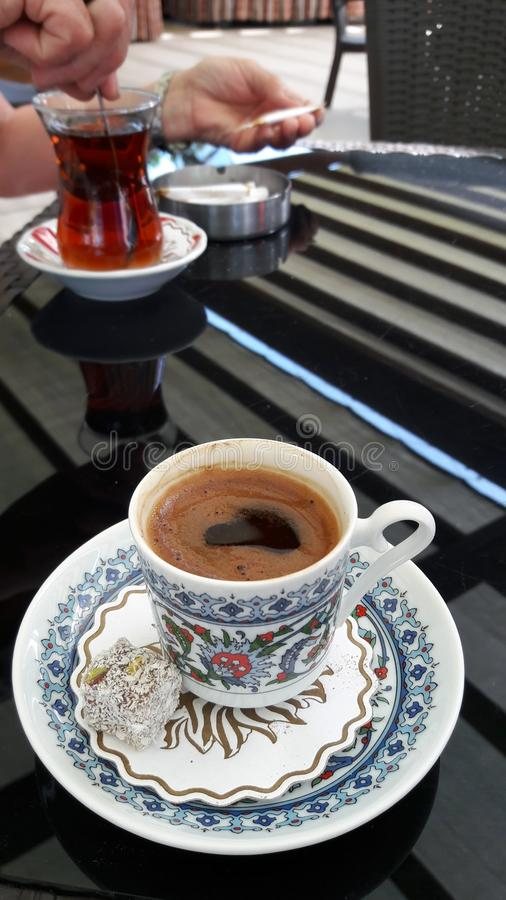 Turkish coffee with sweets on the background of Turkish tea stock photo
