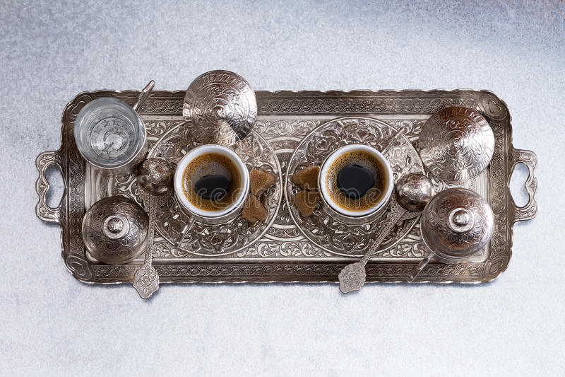 Turkish coffee for two served on a metal tray royalty free stock images