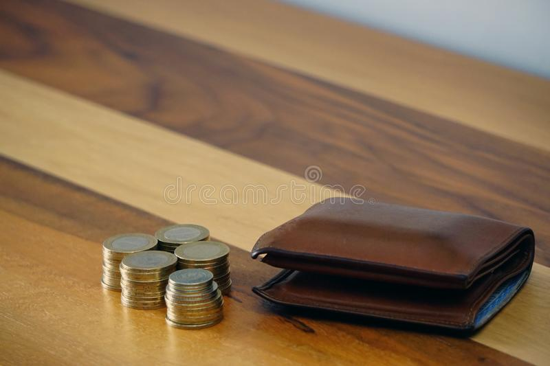 Turkish coin liras and purse on wooden background cleavage for the text available. Turkish coin liras and purse on wooden background cleavage for the text stock photo