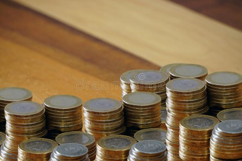 Turkish coin liras and purse on wooden background cleavage for the text available. Turkish coin liras and purse on wooden background cleavage for the text royalty free stock image
