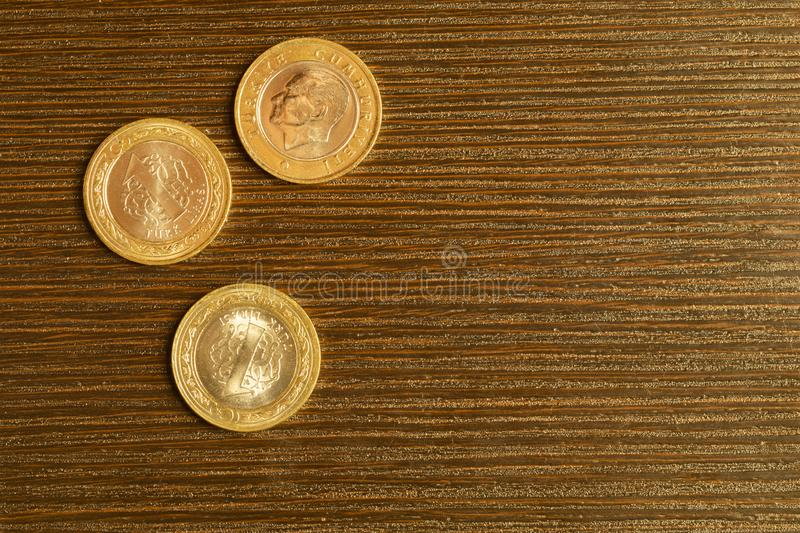 Turkish coins on a wooden background. lira from Turkey close up stock photo