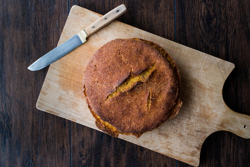 Turkish Cornbread / Misir Ekmegi on wooden surface. Organic food royalty free stock images