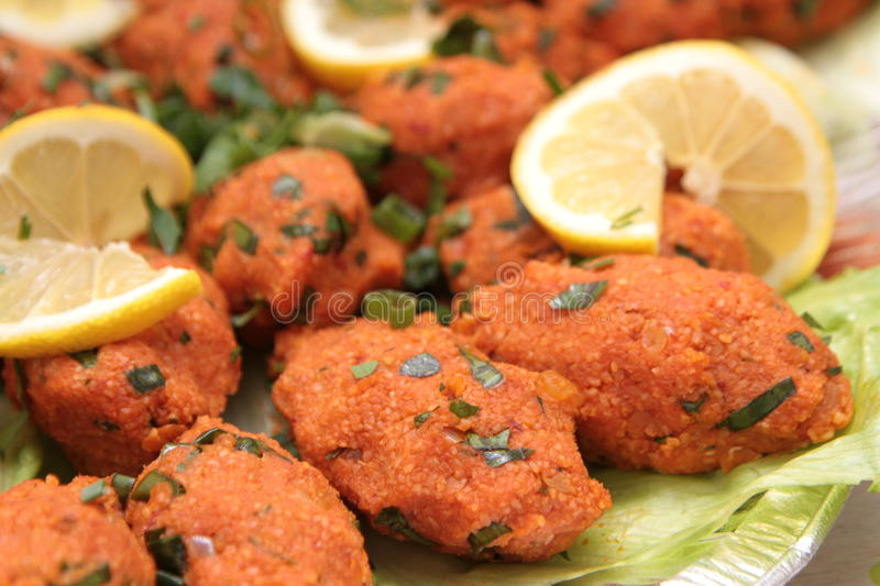 Turkish cuisine. Bulgur and lentil vegetarian dumplings ( Mercimekli Kofte ) stock images