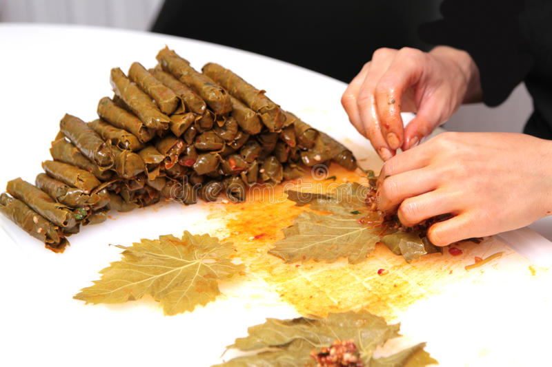 Turkish cuisine. Homemade Sarma - Rice wrapped in grape leaves.  royalty free stock photo
