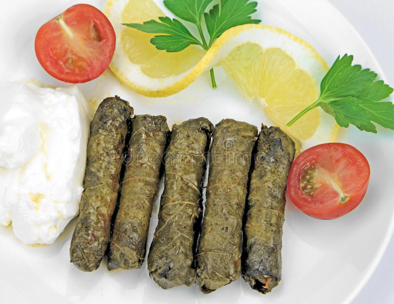 Turkish cuisine. Homemade Sarma - Rice wrapped in vine leaves. Turkish cuisine. Homemade Sarma - Rice wrapped in wine leaves stock images
