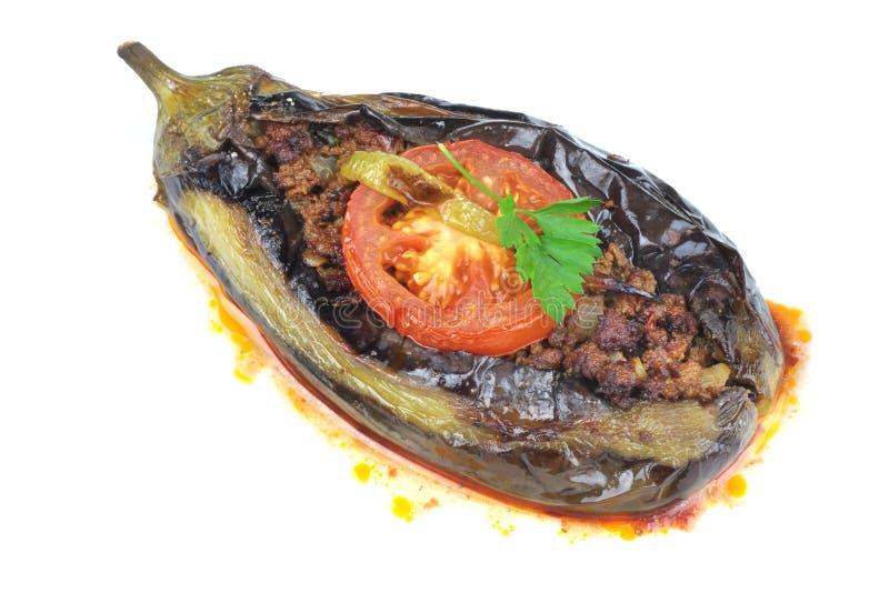 Turkish cuisine. Karniyarik and rice pilaf with black corinth raisin. royalty free stock photography