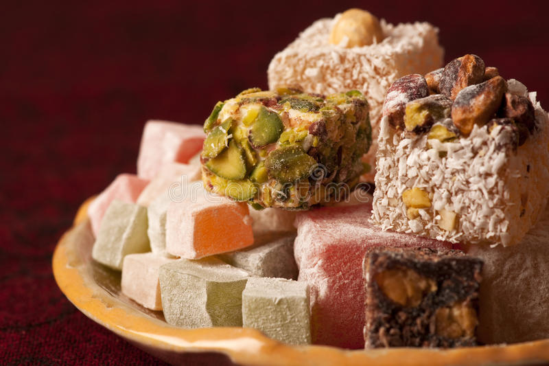 Turkish delight. Plate of assorted turkish sweets royalty free stock photography