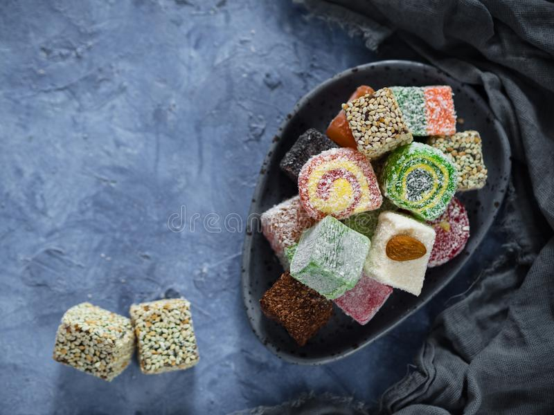 Turkish delight on blue concrete background stock photo