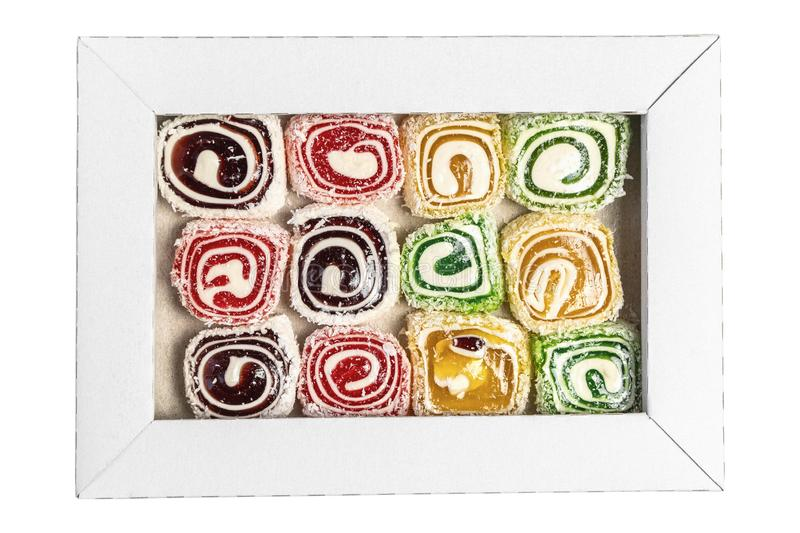 Turkish delight in the box isolated on a white background. Sweet candies in the box. Candy texture stock photo