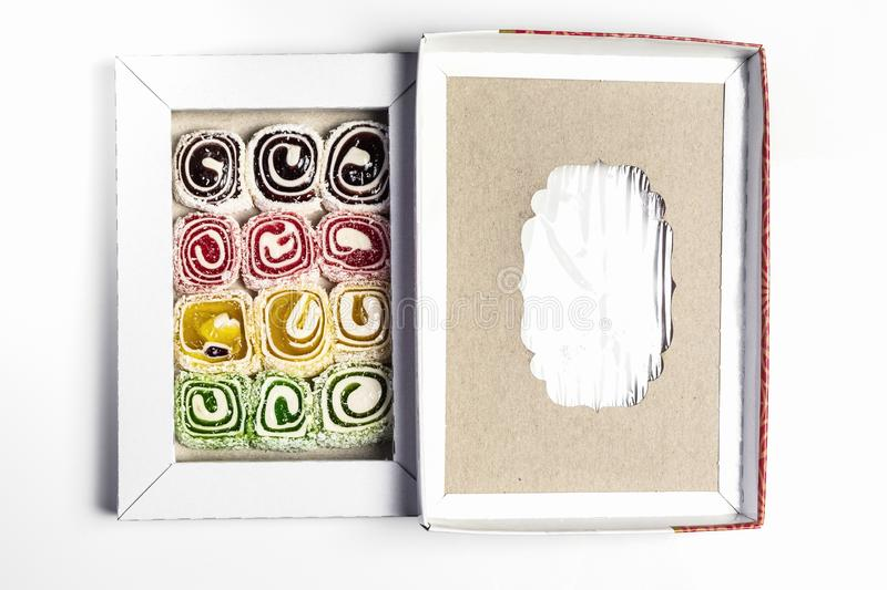 Turkish delight in the box on a white background royalty free stock photography
