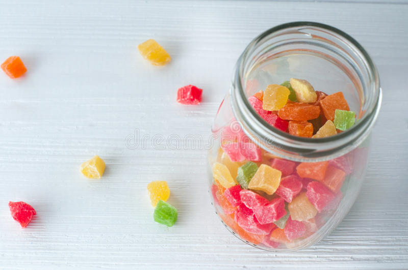 Turkish Delight in glass jar on wood background stock photography