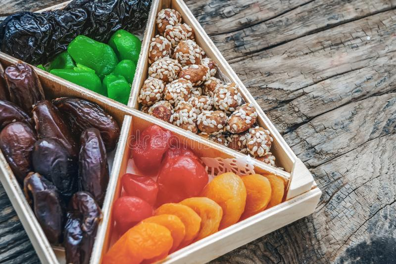Turkish delight oriental sweets dried fruits and nuts in a wooden box. Background. Healthy vegan food. Natural food. Selective. Focus. Copy space royalty free stock photos