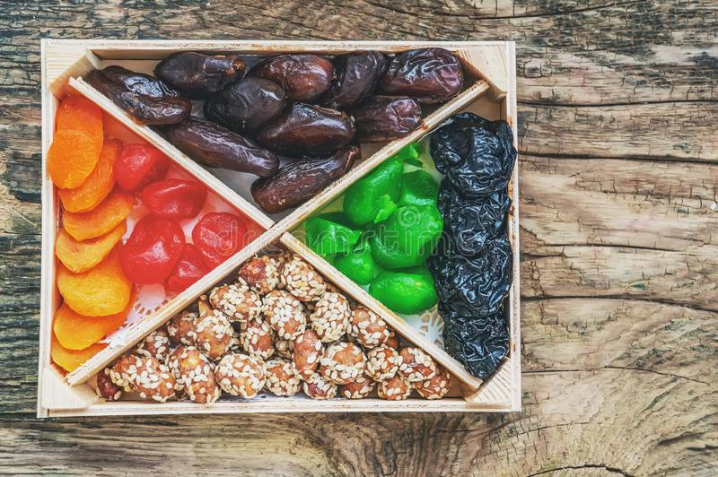 Turkish delight oriental sweets dried fruits and nuts in a wooden box. Background. Healthy vegan food. Natural food. Selective. Focus. Copy space royalty free stock image