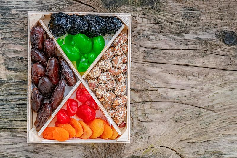 Turkish delight oriental sweets dried fruits and nuts in a wooden box. Background. Healthy vegan food. Natural food. Selective. Focus. Copy space stock photography