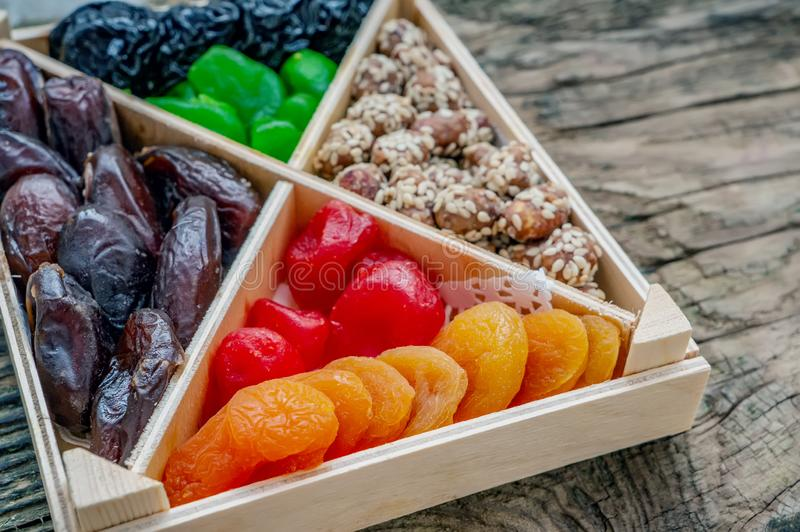 Turkish delight oriental sweets dried fruits and nuts in a wooden box. Background. Healthy vegan food. Natural food. Selective. Focus royalty free stock images