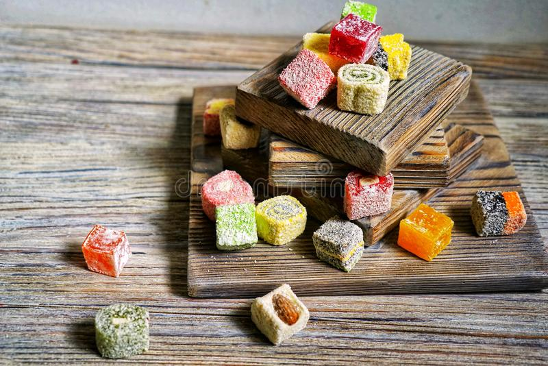 Turkish delight on white rustic background. Turkish deligh set. Assorted traditional turkish delight on oriental background royalty free stock photo