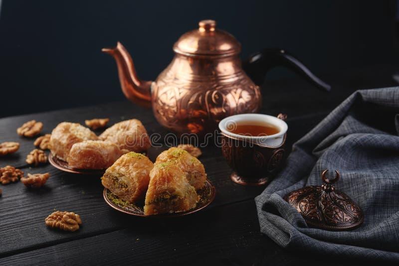 Turkish traditional Dessert Baklava with tea on dark background. Fresh and healthy dessert. royalty free stock image