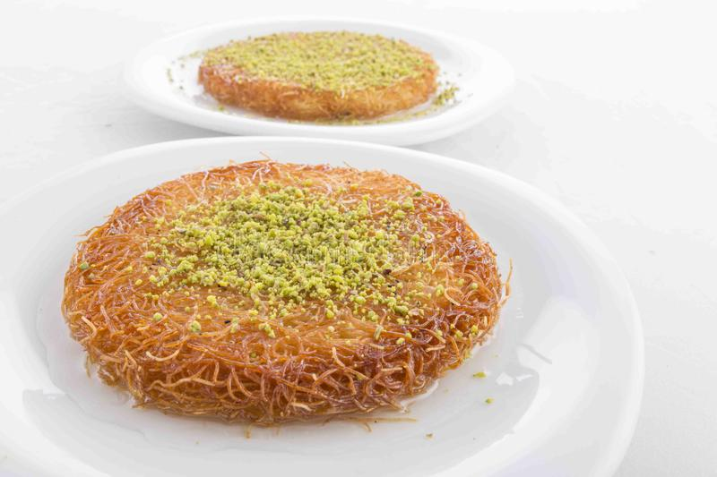 Turkish dessert prepared with cheese and sweet sherbet. With peanut , ıce cream royalty free stock photography