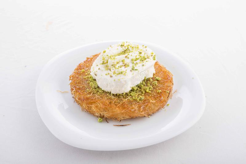 Turkish dessert prepared with cheese and sweet sherbet. With peanut stock image