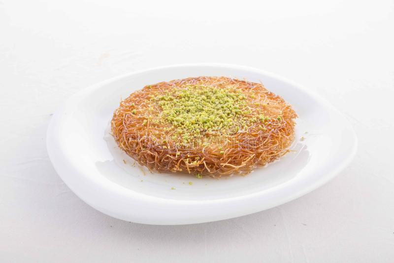 Turkish dessert prepared with cheese and sweet sherbet. With peanut , ıce cream royalty free stock photo