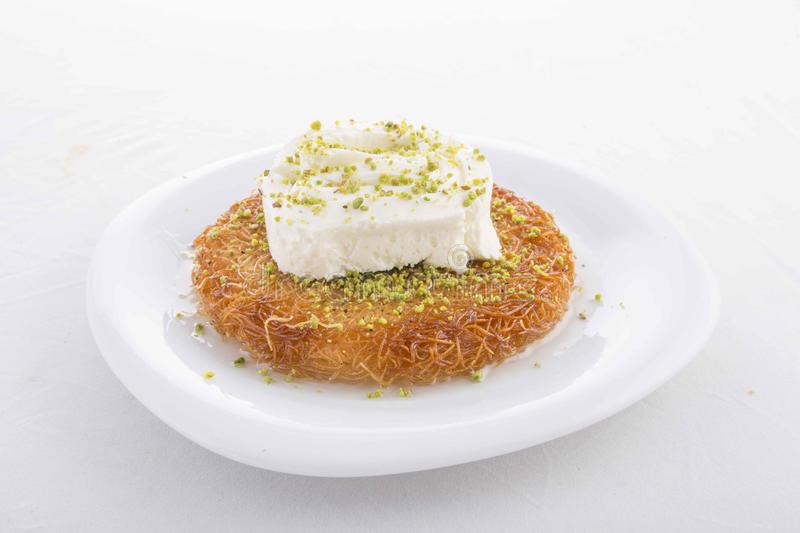 Turkish dessert prepared with cheese and sweet sherbet. With peanut , ıce cream stock photos