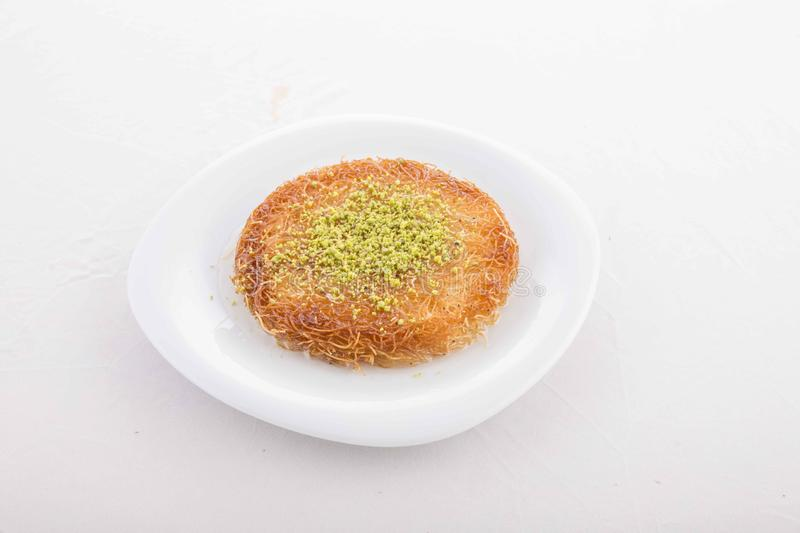 Turkish dessert prepared with cheese and sweet sherbet. With peanut royalty free stock images