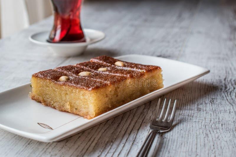 Turkish Dessert Sambali , Sambaba or Damascus with tea. royalty free stock images
