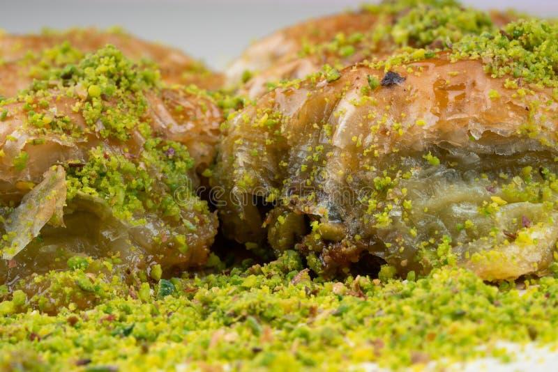 Turkish dessert sobiyet baklava. With pistachio stock photography