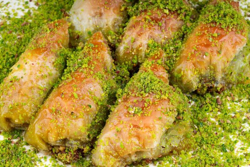 Turkish dessert sobiyet baklava. With pistachio stock photo