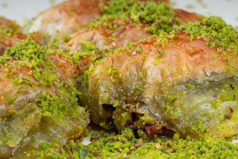 Turkish dessert sobiyet baklava. With pistachio stock images