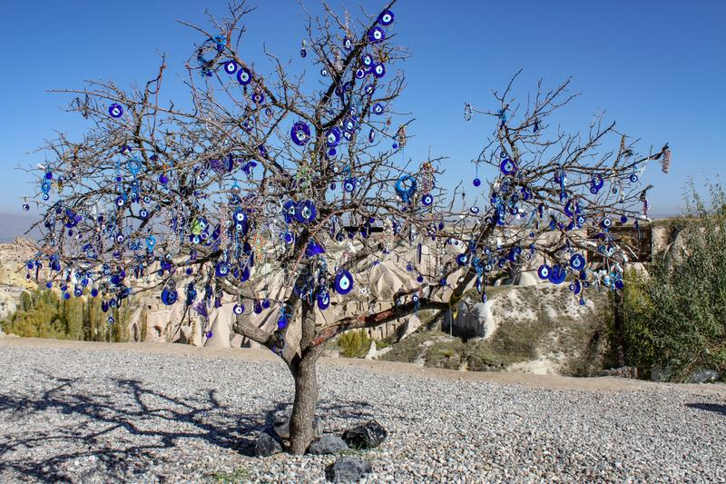 Turkish eye tree. Turkish eye is made from blue glass with the beleive that it can protect  a person who wear it from evil royalty free stock photos