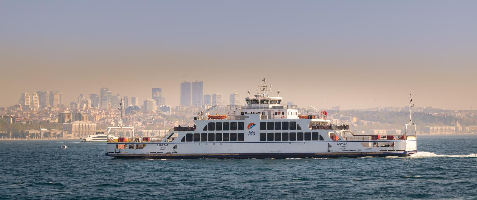 Turkish Ferry boat named Sadabat owned by Istanbul Deniz Otobusleri Co, IDO passing through Marmara Sea. Istanbul, Turkey - April 26, 2017: View from of the sea royalty free stock photography