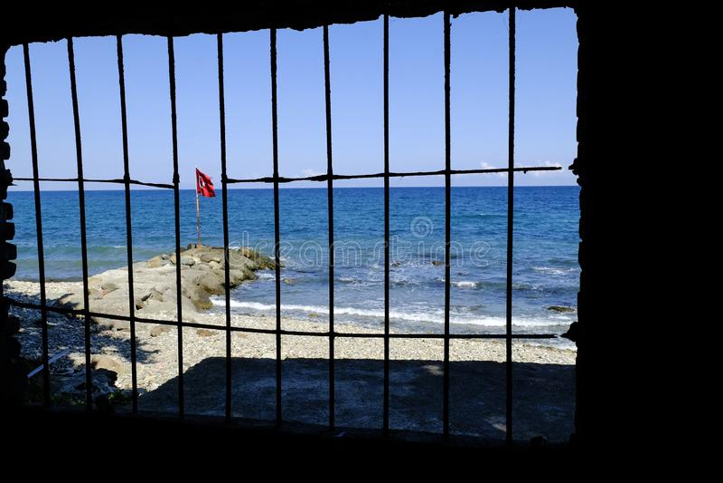 Turkish flag behind bars royalty free stock photography