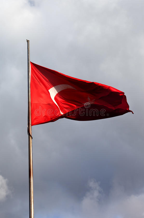 Turkish flag on flagpole royalty free stock photo