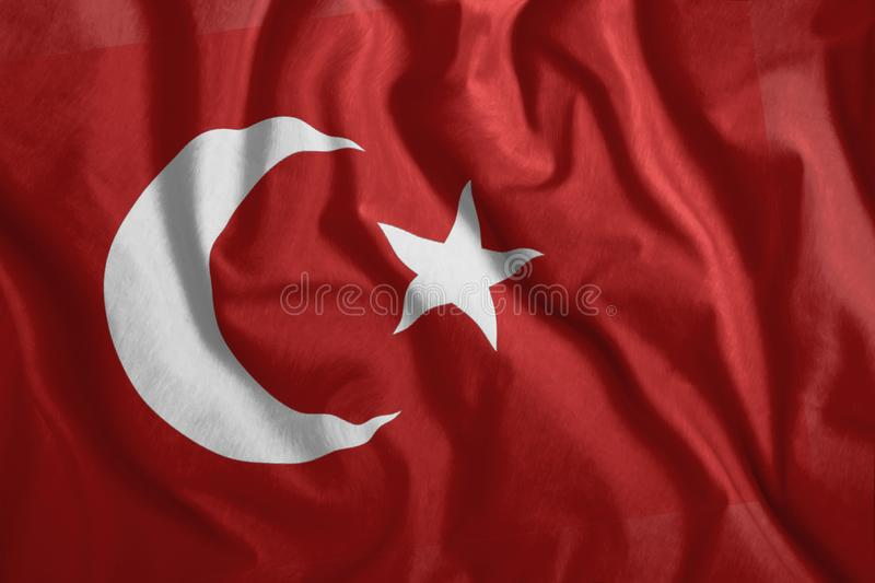 The Turkish flag is flying in the wind. Colorful, national flag of Turkey. Patriotism, a patriotic symbol.  royalty free illustration