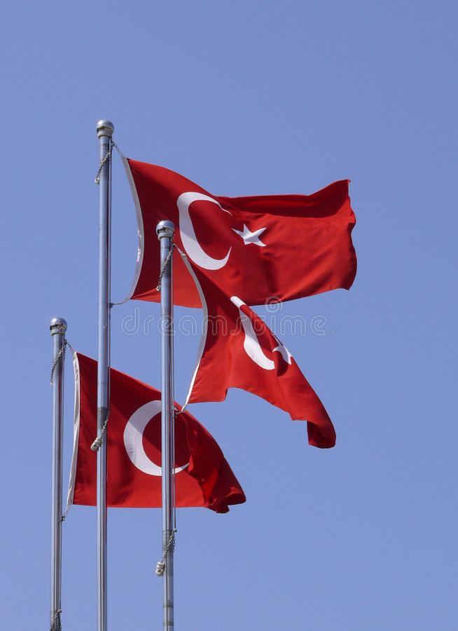 Turkish flags. Three turkish flags waving in the wind in Alanya stock images