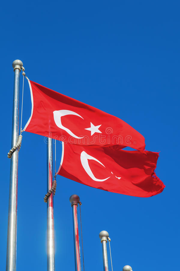 Turkish flags. Against blue sky stock photography