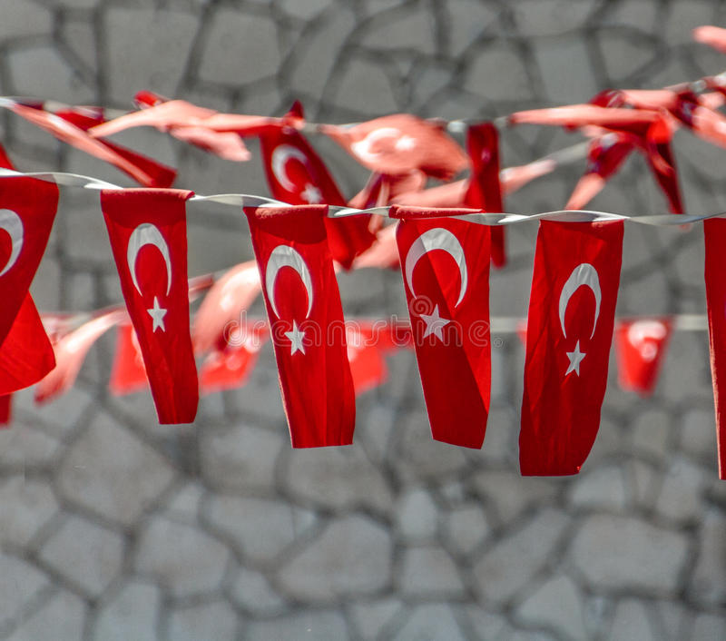Turkish Flags Decoration. In a small resort city of Alaçatı, Turkey streets of Old Town are decorated with festive strings of Turkish Flags royalty free stock photo