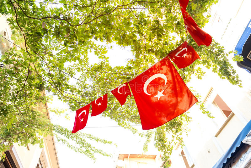 Turkish flags. And View of Kadikoy Popular streets where People love walking and visiting.Kadikoy is one of largest popular and cosmopolitan districts of royalty free stock photos
