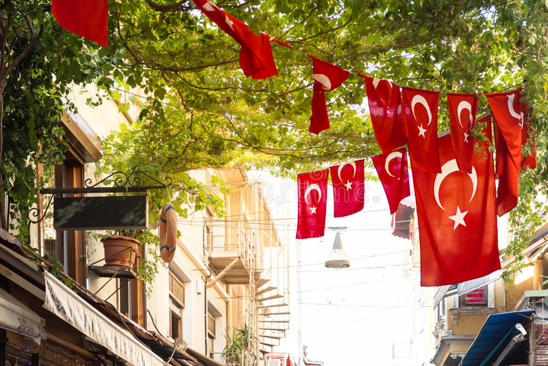Turkish flags. And View of Kadikoy Popular streets where People love walking and visiting. Kadikoy is one of largest popular and cosmopolitan districts of royalty free stock image