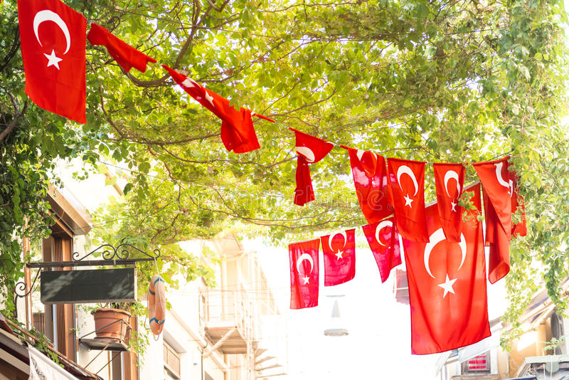 Turkish flags. And View of Kadikoy Popular streets where People love walking and visiting.Kadikoy is one of largest popular and cosmopolitan districts of stock photo