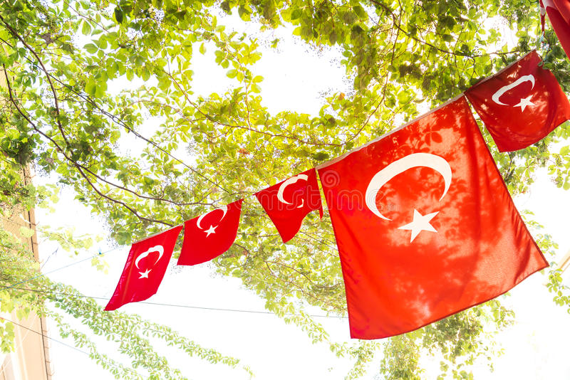 Turkish flags. And View of Kadikoy Popular streets where People love walking and visiting.Kadikoy is one of largest popular and cosmopolitan districts of stock image