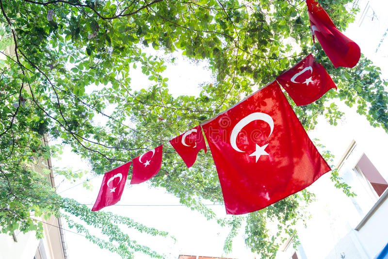 Turkish flags. And View of Kadikoy Popular streets where People love walking and visiting.Kadikoy is one of largest popular and cosmopolitan districts of royalty free stock photo