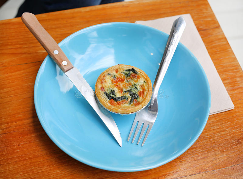 Turkish flat bread with cheese and spinach topping served on a plate. royalty free stock photo