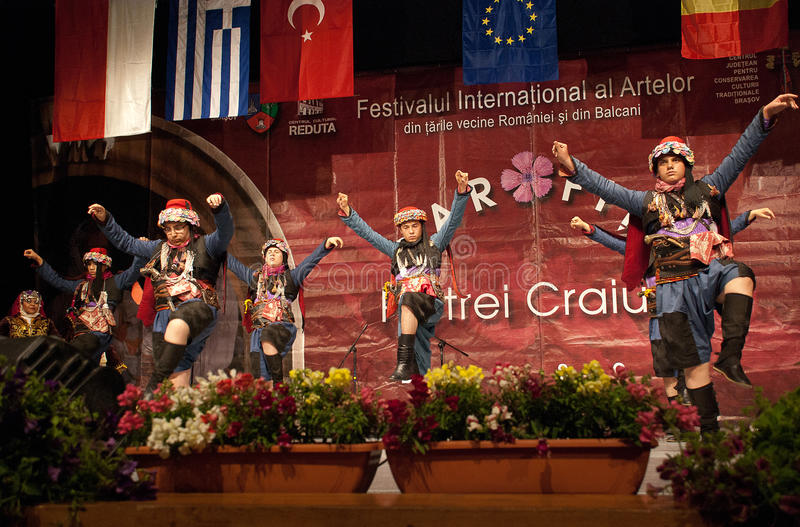"Turkish folk dancers at an international festival. Turkish men folk dancers from a Turkish traditional dance ensemble - called YÖREM"", from Izmir stock photography"
