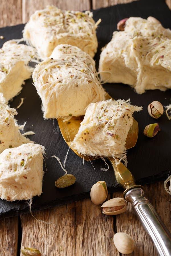 Turkish food: fresh dessert pismaniye with nuts pistachios close stock photo