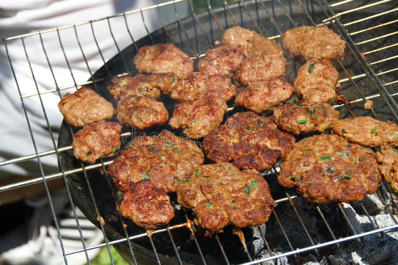 Turkish food, kofte on grill stock images