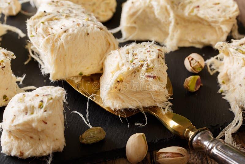 Turkish food: pismaniye with pistachios close-up. Horizontal stock images