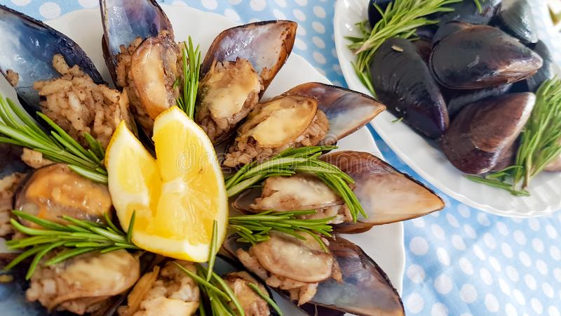 Turkish foods; Turkish style delicious stuffed mussels midye dolma royalty free stock photo